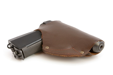 holster: Pistol in a holster on a white background