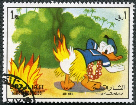 SHARJAH   DEPENDENCIES - CIRCA 1972  A stamp printed by Sharjah   Dependencies devoted fifty years of Walt Disney cartoon characters, shows Donald Duck, series, circa 1972