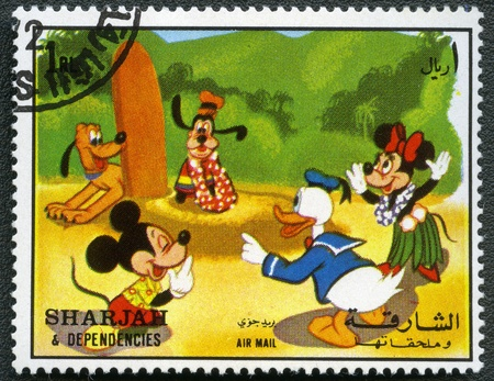 mickey: SHARJAH & DEPENDENCIES - CIRCA 1972: A stamp printed by Sharjah & Dependencies devoted fifty years of Walt Disney cartoon characters, shows Mickey Mouse and friends, series, circa 1972