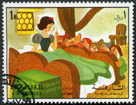 seven dwarfs: SHARJAH & DEPENDENCIES - CIRCA 1972: A stamp printed by Sharjah & Dependencies devoted fifty years of Walt Disney cartoon characters, shows Snow White and the seven dwarfs, series, circa 1972