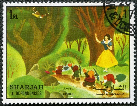 postal card: SHARJAH & DEPENDENCIES - CIRCA 1972: A stamp printed by Sharjah & Dependencies devoted fifty years of Walt Disney cartoon characters, shows Snow White and the seven dwarfs, series, circa 1972