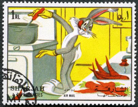 bugs bunny: SHARJAH   DEPENDENCIES - CIRCA 1972  A stamp printed by Sharjah   Dependencies shows Bugs Bunny and Elmer Fudd, Warner Bros, series, circa 1972