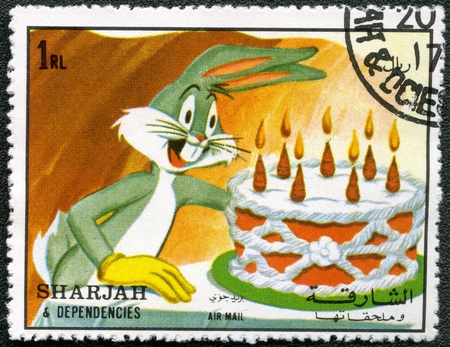 SHARJAH   DEPENDENCIES - CIRCA 1972  A stamp printed by Sharjah   Dependencies shows Bugs Bunny and Elmer Fudd, Warner Bros, series, circa 1972