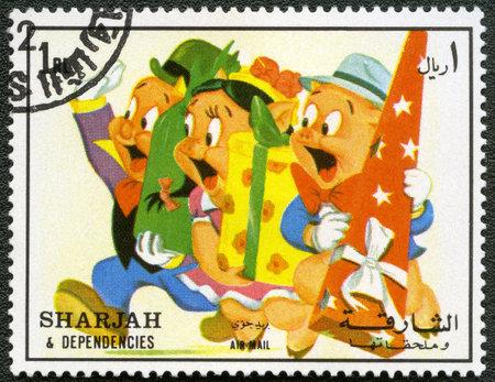 sharjah: SHARJAH   DEPENDENCIES - CIRCA 1972  A stamp printed by Sharjah   Dependencies shows Porky Pig, Warner Bros, series, circa 1972