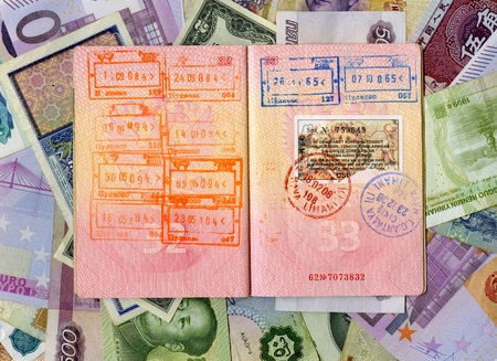 citizenship: Passport with turkish visa and stamps on a different money background Stock Photo