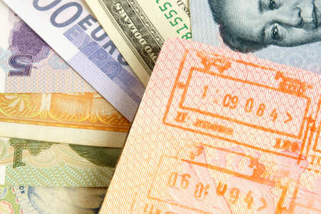 overseas visa: Passport with stamps on a different money background