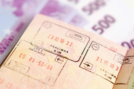 Passport with stamps on a money background Stock Photo - 12505431
