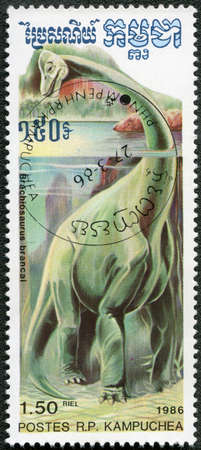 devoted: KAMPUCHEA - CIRCA 1986: A stamp printed by Kampuchea shows Brachiosaurus, series devoted to prehistoric animals, circa 1986