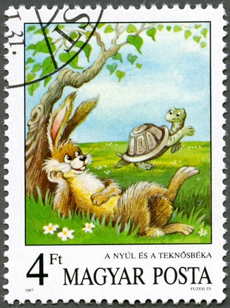 HUNGARY - CIRCA 1987: A stamp printed by Hungary shows the Tortoise and the Hare, Aesop's Fables, Fairy Tales series, circa 1987 Stock Photo