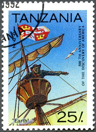 "christopher columbus: TANZANIA - CIRCA 1992: A stamp printed in Tanzania devoted to 500th anniversary of the discovery of America, shows ""Earth!,� first sight of land, circa 1992"