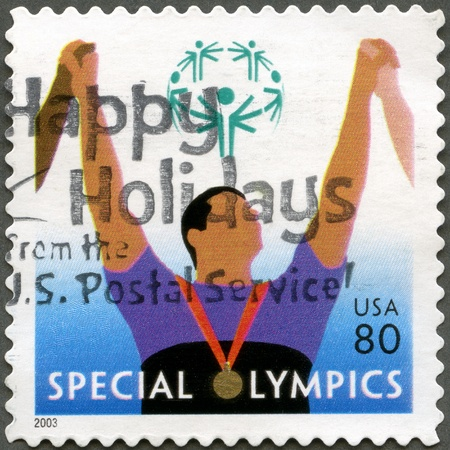 UNITED STATES - CIRCA 2003: A stamp printed by USA, shows Athlete with medal, Special Olympics, circa 2003 Stock Photo - 12950240