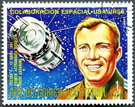 EQUATORIAL GUINEA - CIRCA 1975  A stamp printed by Equatorial Guinea shows Vostok1 and Yuri Gagarin, Apollo-Soyuz Space Project, circa 1975