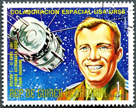 united states postal service: EQUATORIAL GUINEA - CIRCA 1975  A stamp printed by Equatorial Guinea shows Vostok1 and Yuri Gagarin, Apollo-Soyuz Space Project, circa 1975