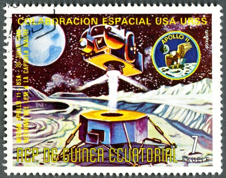 united states postal service: EQUATORIAL GUINEA - CIRCA 1975  A stamp printed by Equatorial Guinea shows Apollo 11 lifts off from the lunar surface, Apollo-Soyuz Space Project, circa 1975