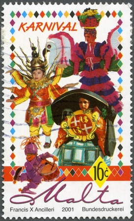 MALTA - CIRCA 2001: A stamp printed by Malta shows Carnival, series, circa 2001 Stock Photo - 12950333