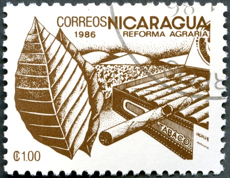 agrarian: NICARAGUA - CIRCA 1986: A stamp printed in Nicaragua shows image of agrarian reform, Tobacco, circa 1986 Stock Photo