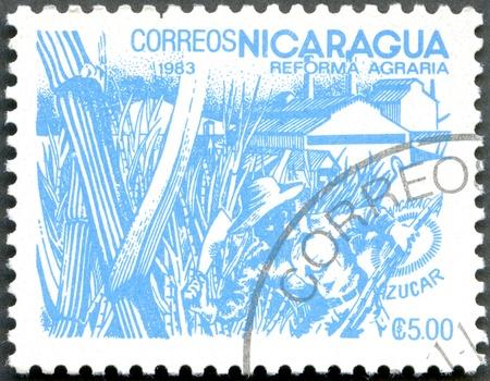NICARAGUA - CIRCA 1983: A stamp printed in Nicaragua shows image of agrarian reform, Sugar, circa 1983 Stock Photo - 12950337