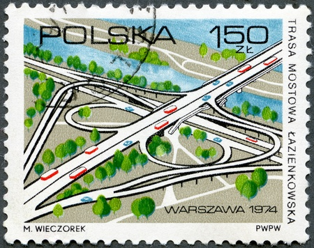 POLAND - CIRCA 1974: A stamp printed by Poland shows Lazienkowska Bridge Road, Opening of Lazienkowska Bridge over Vistula south of Warsaw, circa 1974 photo