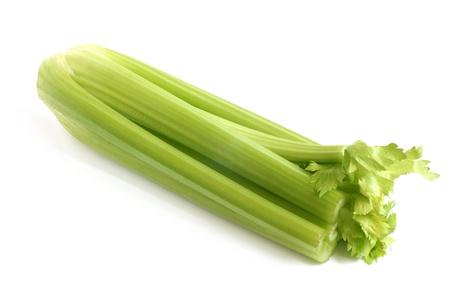Fresh green celery on a white background photo