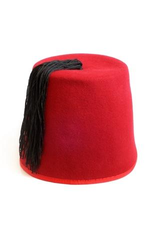 fez: Sombrero turco (fez) sobre un fondo blanco