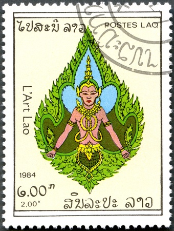 LAOS - CIRCA 1984: A stamp printed in Laos, shows a Deity, circa 1984 Stock Photo - 13023441