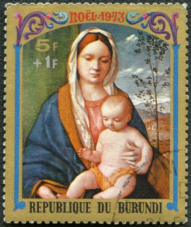BURUNDI - CIRCA 1973: A stamp printed by Burundi shows Virgin and Child by Giovanni Bellini, series Christmas, circa 1973 photo