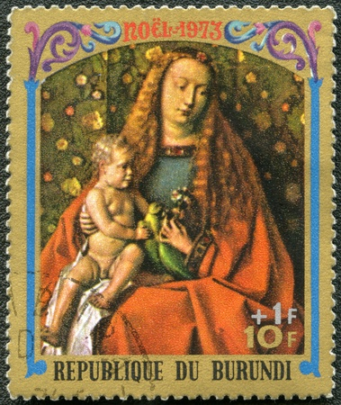 BURUNDI - CIRCA 1973: A stamp printed by Burundi shows Virgin and Child by Jan van Eyck, series Christmas, circa 1973 photo
