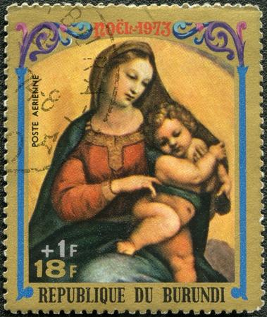 antique jesus: BURUNDI - CIRCA 1973: A stamp printed by Burundi shows Virgin and Child by Raphael, series Christmas, circa 1973