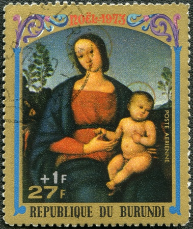 BURUNDI - CIRCA 1973: A stamp printed by Burundi shows Virgin and Child by Pietro Perugino, series Christmas, circa 1973 photo