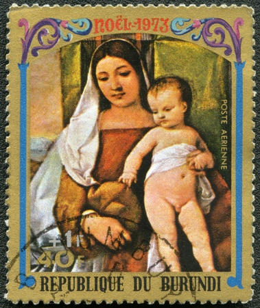BURUNDI - CIRCA 1973: A stamp printed by Burundi shows Virgin and Child by Titian, series Christmas, circa 1973 photo