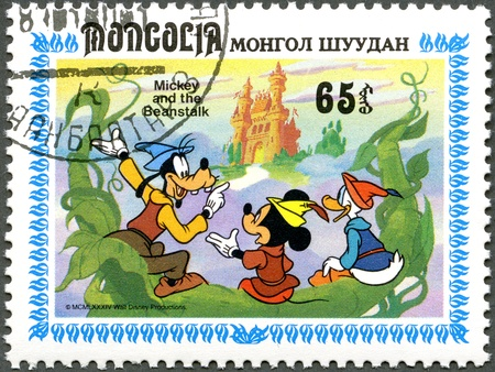 disney cartoon: MONGOLIA - CIRCA 1984: A stamp printed by Mongolia shows Scenes from Walt Disneys Mickey and  the Beanstalk, series, circa 1984 Editorial