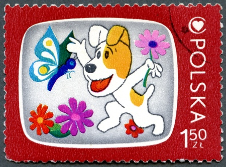 POLAND - CIRCA 1975: A stamp printed in Poland shows Reksio, the dog, Cartoon Characters and Children's Health Center Emblem, series, circa 1975 photo