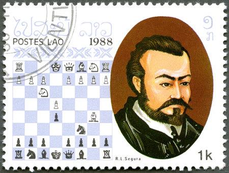 chess player: LAOS - CIRCA 1988: A stamp printed in Laos, shows Rodrigo (Ruy) Lopez de Segura , Chess Champion, circa 1988