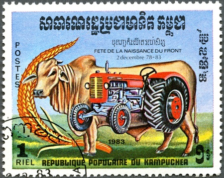 KAMPUCHEA - CIRCA 1983: A stamp printed by Kampuchea shows bull and tractor, series devoted to Festival of Rebirth, circa 1983 photo