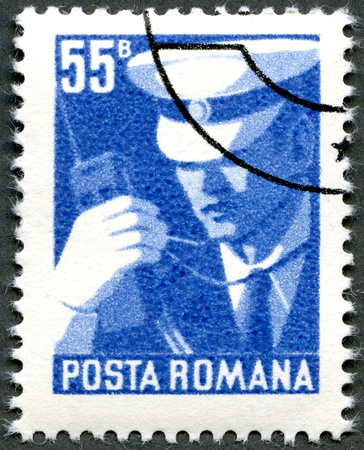 commemorate: ROMANIA - CIRCA 1975: A stamp printed by Romania shows policeman with walkie-talkie, publicity for traffic rules, circa 1975 Stock Photo
