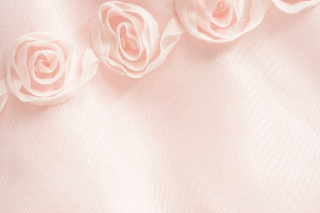 Pink textile background with roses, for backgrounds or textures photo