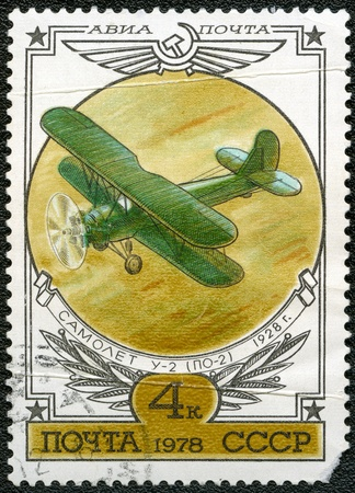 postal card: USSR - CIRCA 1978: A stamp printed by USSR shows Aviation Emblem and PO-2 biplane (U-2), 1928, series, circa 1978 Stock Photo