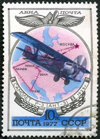 USSR - CIRCA 1977: A stamp printed by USSR shows Aviation Emblem and R-3 (ANT-3) biplane, 1925, series, circa 1977 photo