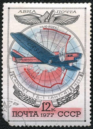 USSR - CIRCA 1977: A stamp printed by USSR shows Aviation Emblem and  TB-1 (ANT-4) monoplane, 1925, series, circa 1977 photo