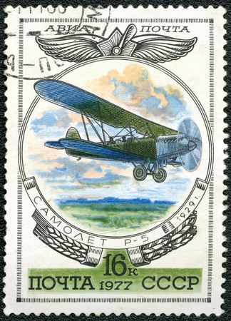 USSR - CIRCA 1977: A stamp printed by USSR shows Aviation Emblem and R-5 biplane, 1929, series, circa 1977 photo