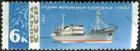 USSR - CIRCA 1967: A stamp printed in USSR shows Fishing trawler, series  photo