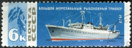 USSR - CIRCA 1967: A stamp printed in USSR shows Trawler fish factory and fish, series  photo