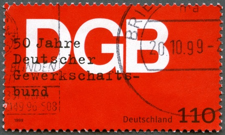 GERMANY- CIRCA 1999: stamp printed by Germany shows German Federation of Trade Unions (DGB), 50th anniversary, circa 1999 Stock Photo - 13518792