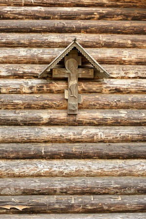The Crucifixion of Jesus Christ on a wooden wall photo
