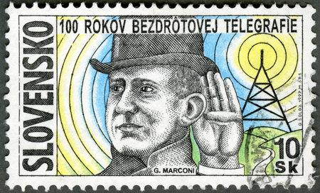 SLOVAKIA - CIRCA 1997: A stamp printed in Slovakia shows Guglielmo Marconi, inventor of radio, circa 1997 Stock Photo - 13581027