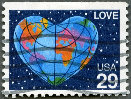united states postal service: UNITED STATES OF AMERICA - CIRCA 1991  A stamp printed in USA shows word  love  and Earth in Form of the Heart, circa 1991 Stock Photo
