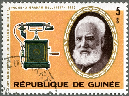 GUINEA - CIRCA 1976: A stamp printed by Guinea shows Alexander Graham Bell (1847-1922), telephone, circa 1976 Stock Photo - 13581034
