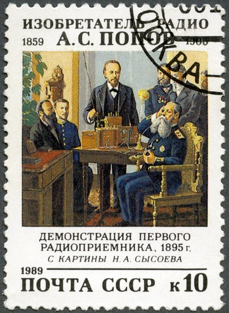 USSR - CIRCA 1989: A Stamp printed in USSR shows Aleksandr Popov (1859-1905), Inventor of Radio in Russia, Demonstration of the First Radio Receiver, 1895, by N. Sysoev, circa 1989 Stock Photo - 13624630