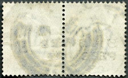 The reverse side of a postage stamp on a black background photo