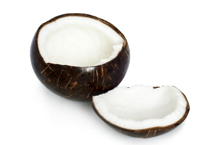 Two halves of coconut on a white background photo